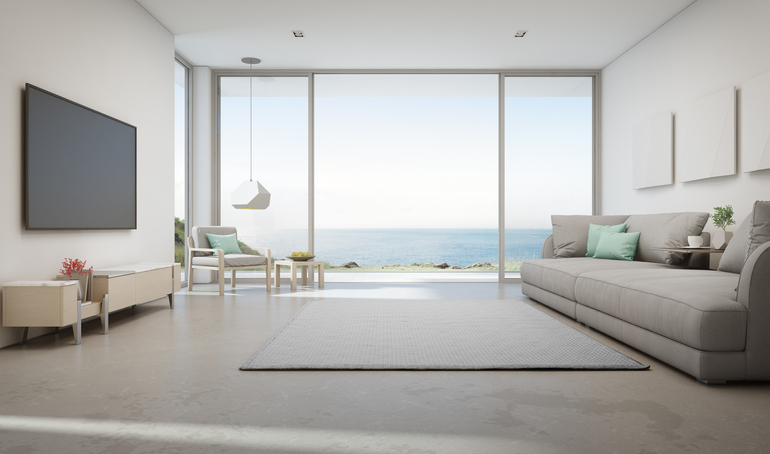image showing a bedroom with a view of the beach